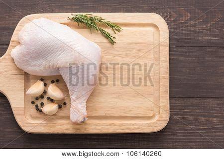 Raw Chicken Leg On Cutting Board On Wooden Background