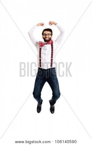 Funny man wearing suspenders jumping up.