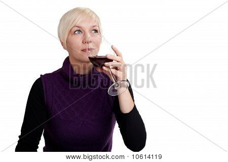 Young Woman Tasting Red Wine