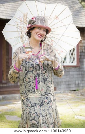 Beautiful 1920s Dressed Girl with Parasol and Glass of Wine Portrait.