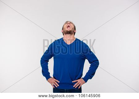 Portrait of a young man screaming isolated on a white background