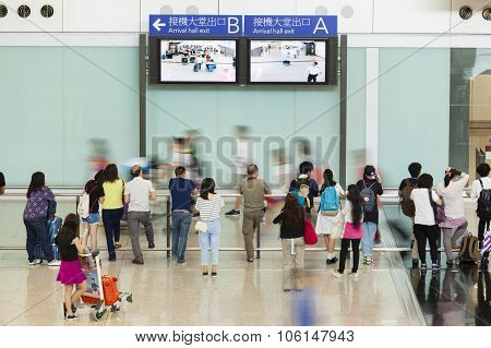 People at the arrival hall of an airport