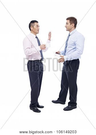 Asian And Caucasian Businessmen Talking