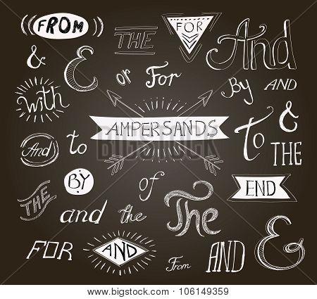 Vintage hand lettered ampersands and catchwords for Logo web designs on a chalkboard