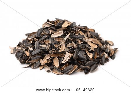 Pile of sunflower husks isolated on white