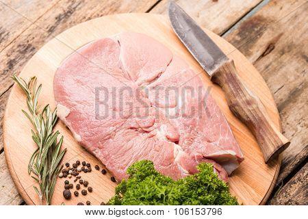 Big Chunk Of Beef On Cutting Board