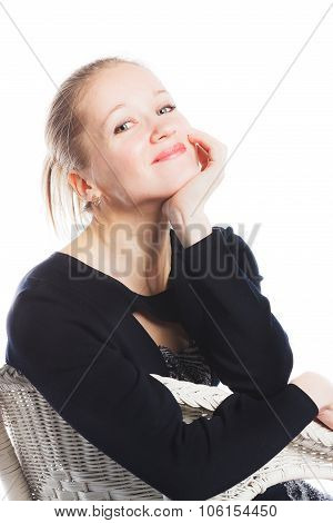 Close up of happy woman sitting in arm-chair