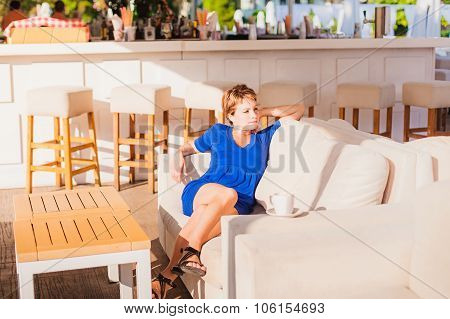 Young beautiful woman with a cup of coffee