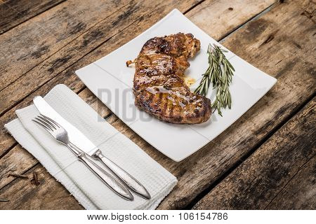 Grilled Beefsteak Decorated With Rosemary Bunch