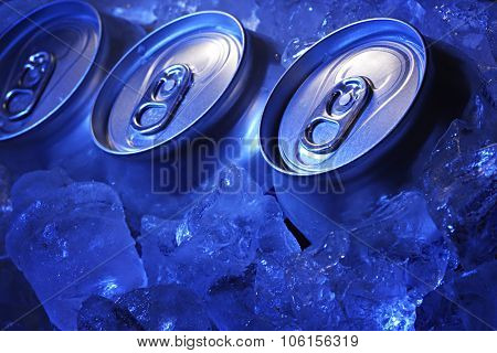 aluminum can of soda in the ice