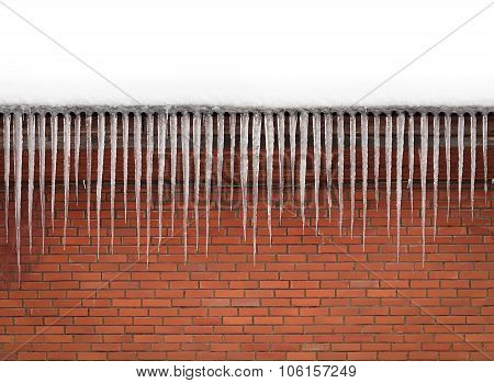 Pretty Icicles On Brick Wall Background