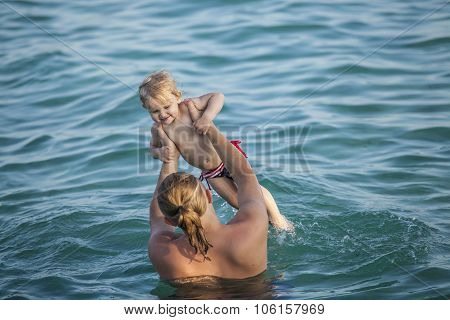 Happy Child With Father At Sea, A Fun Play