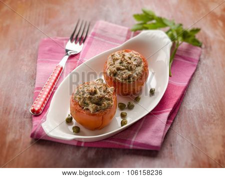stuffed tomatoes with tuna and capers, selective focus