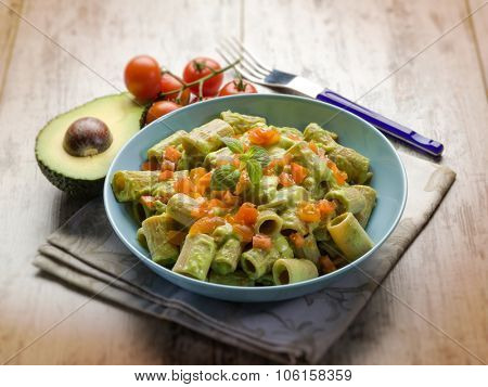 pasta with avocado and tomatoes, selective focus