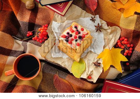 Romantic autumn still life with blanket, cake, book, coffee cups and leaves, top view