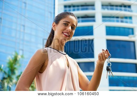 Portrait Of New House Owner Holding Apartment Keys