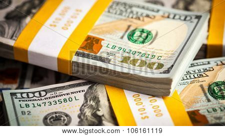 Creative business finance making money concept - panoramic background of new 100 US dollars 2013 edition banknotes (bills) bundles close up