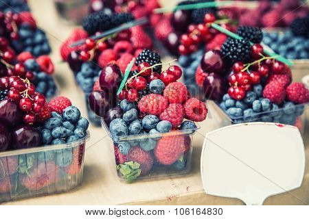 Berry fruits at a marketplace Blueberries, raspberries, strawberries, cherries Forest fruits. Garden