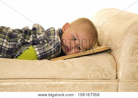 Young Boy Lay On Book