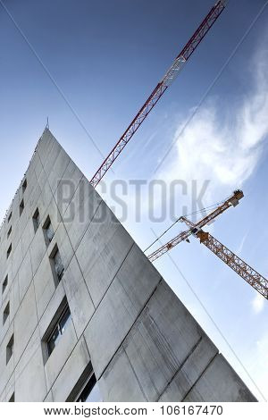 Modern Building And Cranes