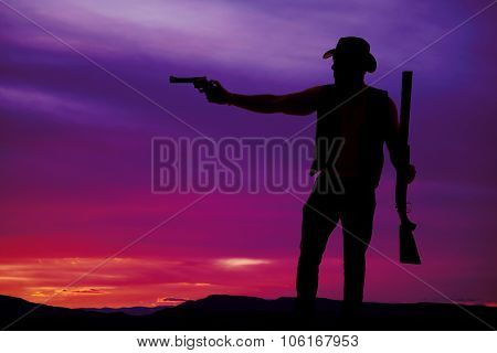 Silhouette Of A Cowboy Shotgun In Hand Pistol Pointed