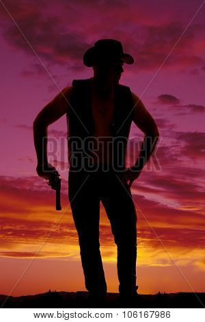 Silhouette Of A Cowboy With A Pistol Down In Sunset