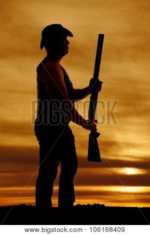 Silhouette Of Cowboy With Shotgun Out In Sunset