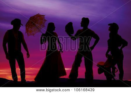 Silhouette Of Cowboys And Women