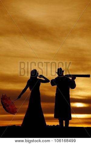 Silhouette Of Woman With Umbrella And Guy With Gun