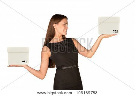 Smiling businesslady holding two white boxes