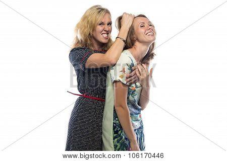 Two joking blond sisters