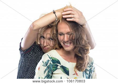 Two joking blond women