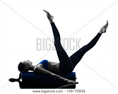 one caucasian woman exercising pilates roller exercises fitness in silhouette isolated on white backgound
