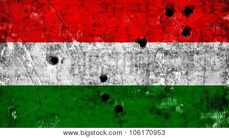 Flag of Hungary, Hungarian Flag painted on solid texture with bullet holes