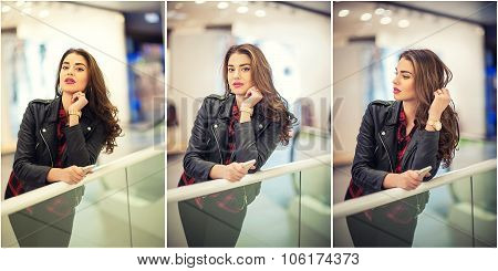 Attractive young woman fashion shot in mall. Beautiful fashionable young girl in leather jacket