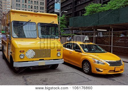 Traditional Yellow Taxi And A Van In Manhattan Street