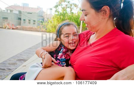 Little Girl Happy In Her Mother's Lap