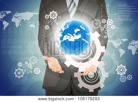 Businessman with planet above his hands on blue