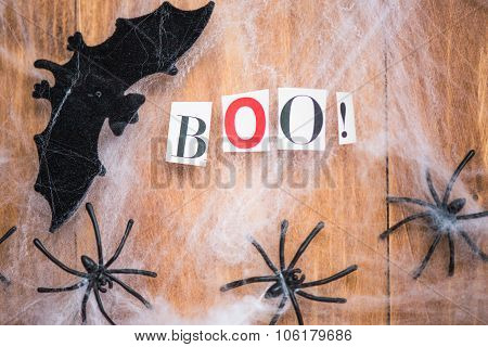 Halloween Symbols Bats, Web And Black Spiders On Wooden Background