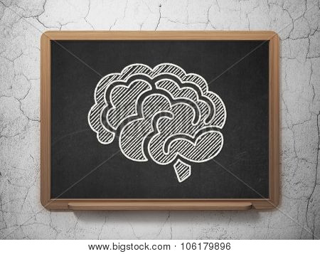 Science concept: Brain on chalkboard background