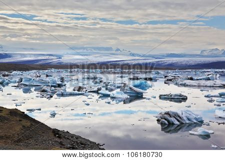 Icebergs and ice floes in the Ice Lagoon Yokulsarlon. Iceland in July
