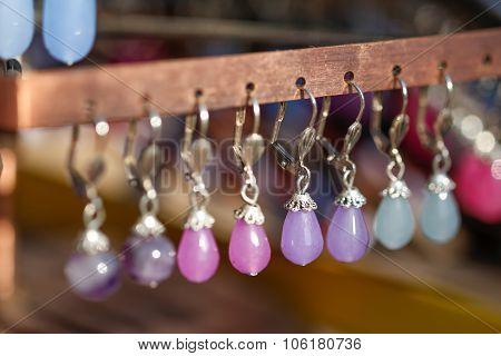 Hanging earrings.