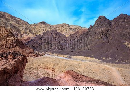 Dry stone desert near the southern seaside resort of Eilat, Israel. The dirt road at the foot of King Solomon