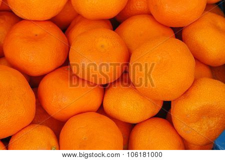 Tangerines as the background.