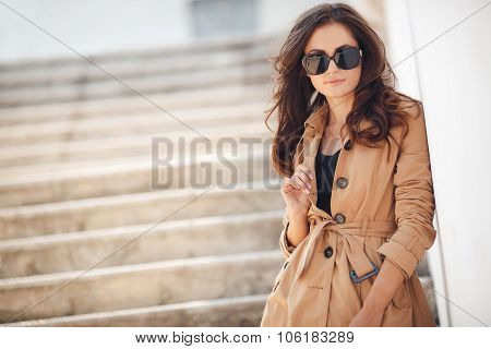 Portrait of a beautiful brunette in autumn colors