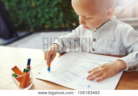 Small Boy Entertaining Himself Drawing