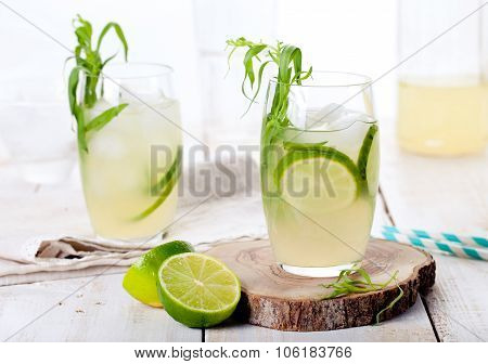 Lime cucumber lemonade cocktail on a white table