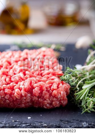 Minced meat on a slate stone black board.