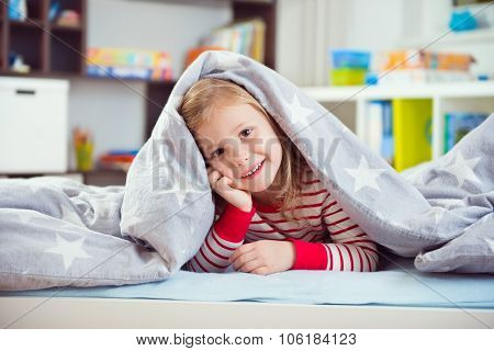 Pretty Little Girl Lying Under Blanket