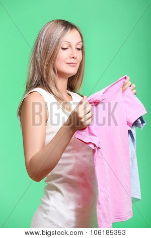 woman trying clothing dress while shopping